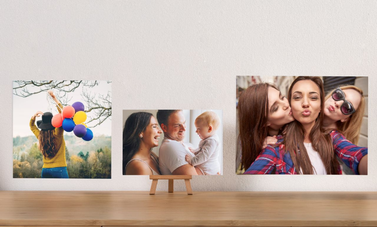 large photo prints display and hung on a wall.