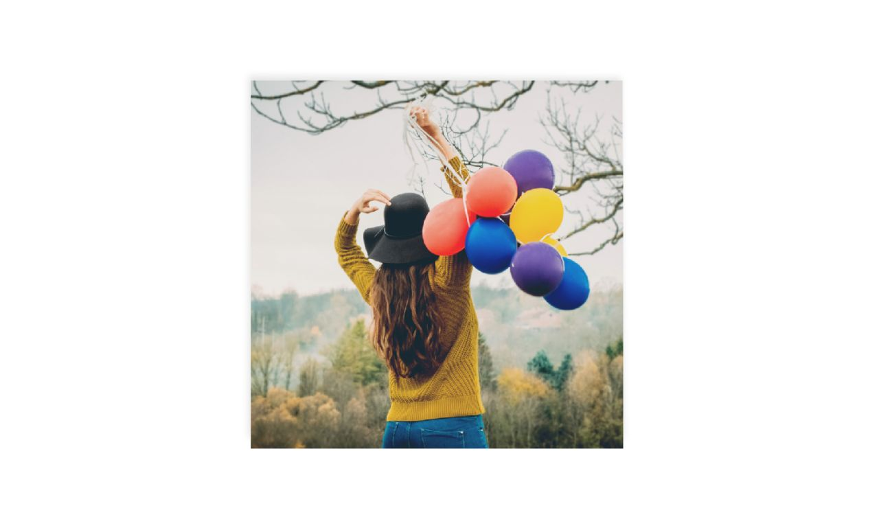 photo of woman outside with balloons printed as square wall art